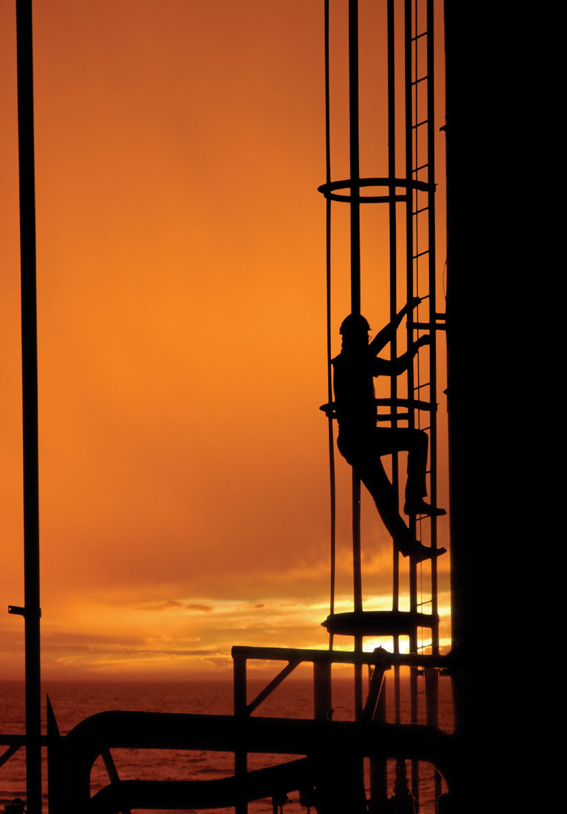 Construction-Worker-Climbing-on-Oil-Tanker
