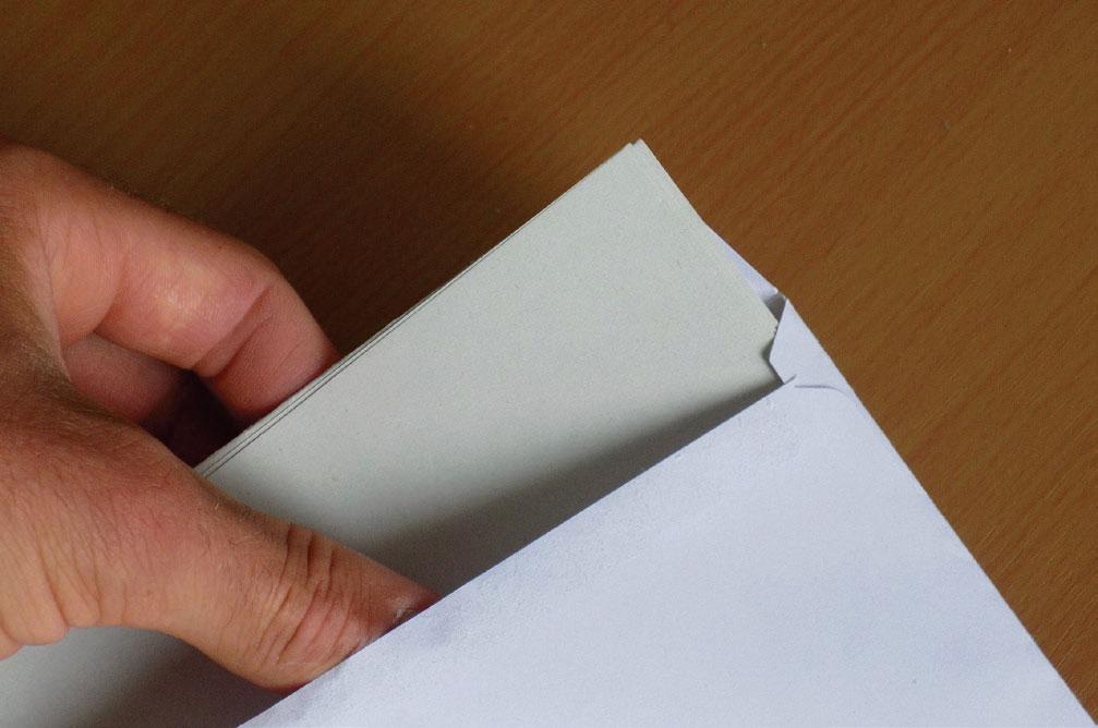 Removing-Letter-from-Envelope